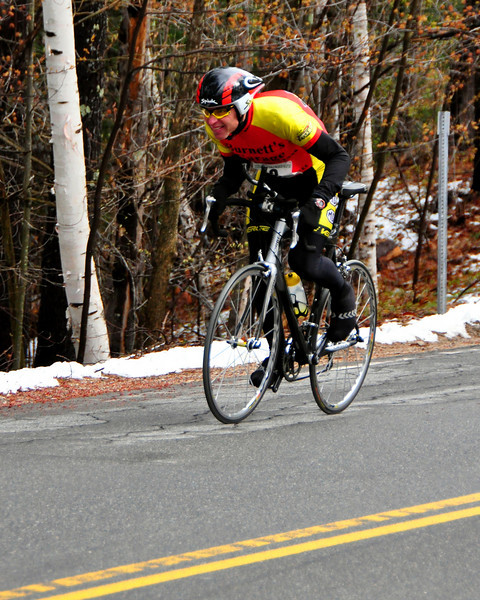 An entrant competes in 10th Anniversary of The Tuckerman Inferno Pentathlon, on April 18th, 2010. The five stage event, consists of an 8.3 mile run, 6 mile Kayak, 18 mile bike race, then the 3 mile Inferno hike from the Pinkham Notch base into Tuckerman Ravine, with the final leg being a ski race through a course set in the ravine.