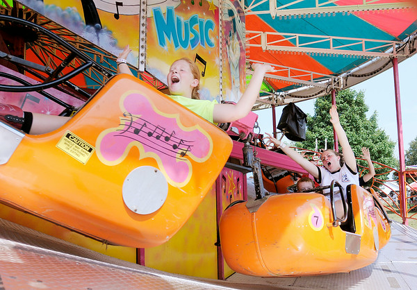 Don Knight   The Herald Bulletin<br /> Visitors to the 4-H Fair enjoy the midway rides on Tuesday in Alexandria.