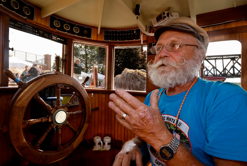 . Capt. Ben Grudinskas in the bridge of his Atlantic Hunter II Tug at Waterford\'s Tugboat Roundup .Saturday 09/07/13 (Mike McMahon/The Record)