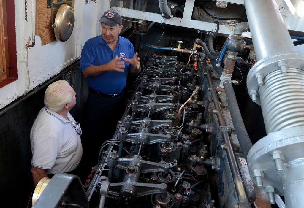 . Brian Young talks with Mike Steele in the engine room of the Tug Buffalo at Waterford\'s Tugboat Roundup .Saturday 09/07/13 (Mike McMahon/The Record)