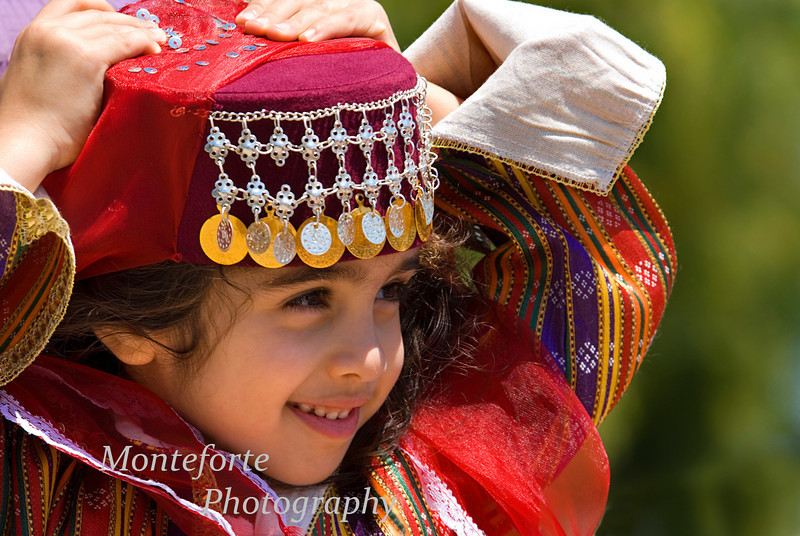 Girl in traditional costume at Turkish Festival, Monterey Ca.