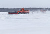 Clearing the runways at Moosonee Airport.