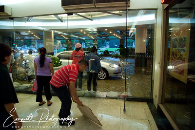 Trying to keep water outside of Glorietta Mall, Makati, Philippines.  Where the car is driving is normally a walkway.