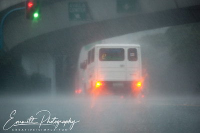 Visibility decreases and cars start to struggle on EDSA, Makati, Philippines.