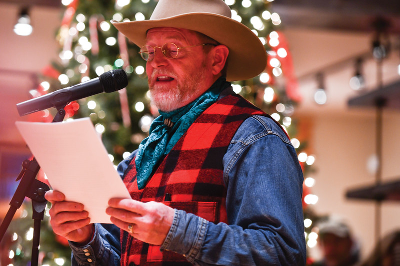 Matthew Gaston | The Sheridan Press<br>Author Craig Johnson reads from a selection of humorous short stories that will be published next during the Ucross Community Christmas Celebration Saturday. Dec. 15, 2018.