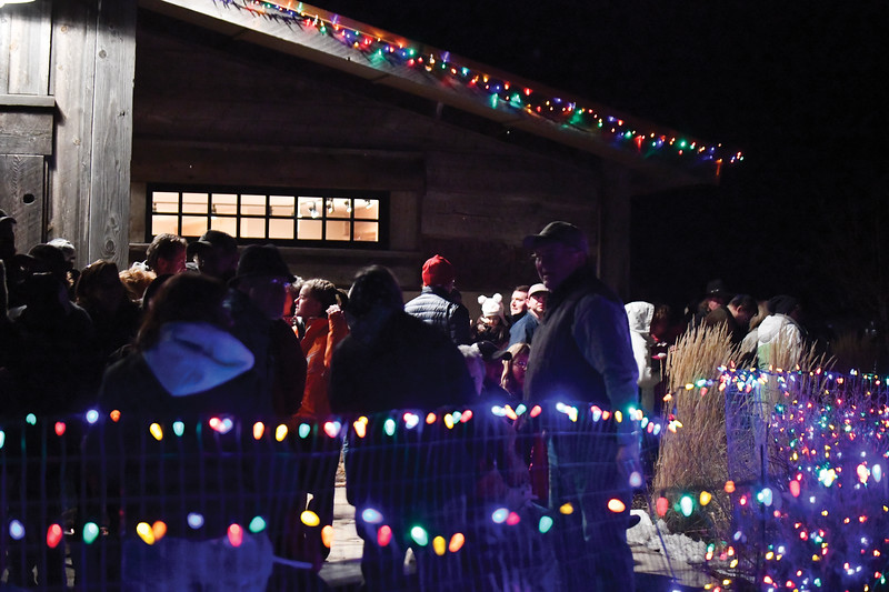 Matthew Gaston | The Sheridan Press<br>The crowd gathered at the Raymond Plank Creative Center in Ucross mingle and talk about the impressive fireworks display put on by Bruce Burns for the Ucross Community Christmas Celebration Saturday, Dec. 15, 2018.