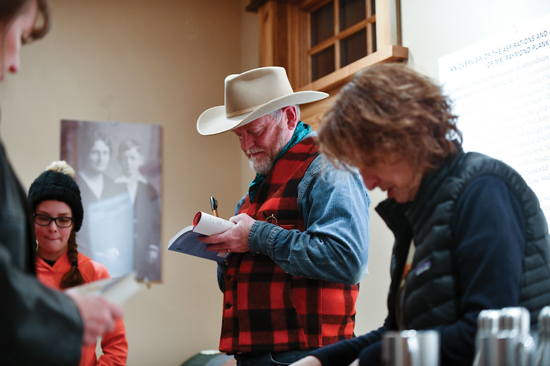 Matthew Gaston | The Sheridan Press<br>New York Times best selling author Craig Johnson autographs copies of his books at the Ucross Community Christmas Celebration Saturday, Dec. 15, 2018.