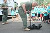 SWAT members Tom Szybowski and Mike Milligan show UD Jr. Police Academy cadets a remote robot.