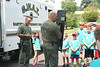 SWAT members Tom Szybowski and Mike Milligan show UD Jr. Police Academy campers a shield.