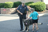 Montgomery Township police K9 Officer Rose holds his dog, Duke, for cadets to pet.