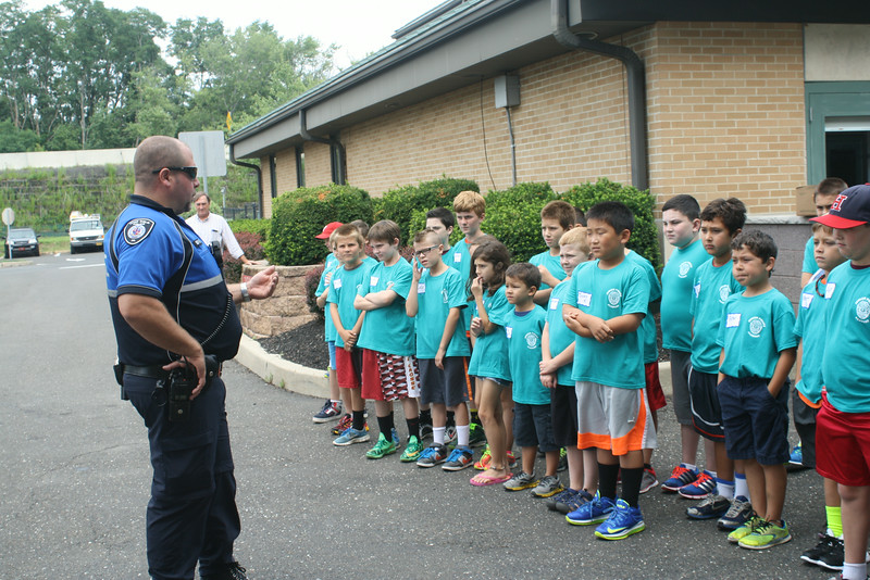 Upper Dublin police Detective Mike Scarpato tells the 2014 U.D. Junior Police Academy cadets about the SWAT demonstration they are about to see.