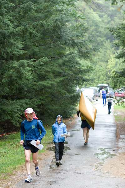 Finishers coming in, canoe going back to the parking lot.