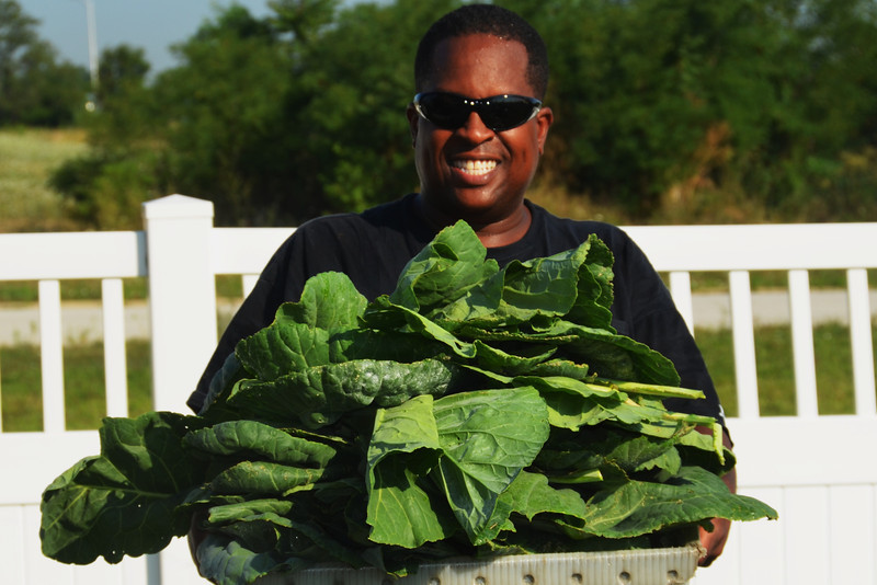 W. Deen Mohammed II - Sharing collard greens (on the way to The Mosque Cares building)