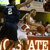 Dec 12, 2009; Raleigh, NC, USA; North Carolina State Wolfpack guard Julius Mays (24) looks for a pass during the first half while defended by Georgia Southern Eagles forward Rory Spencer (2) at Reynolds Coliseum.  The Wolfpack defeated the Eagles 75-57.  Mandatory Credit: Brian Utesch-US PRESSWIRE