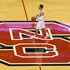 Jan 6, 2010; Raleigh, NC, USA; North Carolina State Wolfpack guard Javier Gonzalez (10) brings the ball up court during the first half against the Holy Cross Crusaders at the RBC Center.  The Wolfpack defeated the Crusaders 87-70.  Mandatory Credit: Brian Utesch-US PRESSWIRE