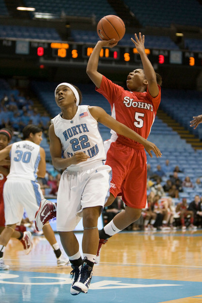 Dec 6, 2009; Chapel Hill, NC, USA; St. John's Red Storm guard Nadirah McKenith (5) shoots the ball while defended by North Carolina Tar Heels guard Cetera DeGraffenreid (22) during the first half at the Dean Smith Center.  The Tar Heels defeated the Red Storm 83-73.  Mandatory Credit: Brian Utesch-US PRESSWIRE