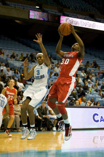 "Dec 6, 2009; Chapel Hill, NC, USA; St. John's Red Storm forward Centhya ""Coco"" Hart (30) shoots the ball while defended by North Carolina Tar Heels forward Trinity Bursey (3) during the first half at the Dean Smith Center.  The Tar Heels defeated the Red Storm 83-73.  Mandatory Credit: Brian Utesch-US PRESSWIRE"