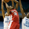 "Dec 6, 2009; Chapel Hill, NC, USA; St. John's Red Storm forward Centhya ""Coco"" Hart (30) goes to the basket with North Carolina Tar Heels forwards Laura Boomfield (33) and Trinity Bursey (3) defending during the first half at the Dean Smith Center.  The Tar Heels defeated the Red Storm 83-73.  Mandatory Credit: Brian Utesch-US PRESSWIRE"