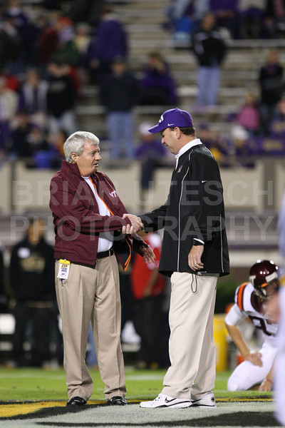 Nov 5, 2009; Greenville, NC, USA; Virginia Tech Hokies coach Frank Beamer and East Carolina Pirates coach Skip Holtz meet prior to the game at Dowdy-Ficklen Stadium.  Mandatory Credit: Brian Utesch-US PRESSWIRE