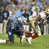 Oct 22, 2009; Chapel Hill, NC, USA; Florida State Seminoles wide receiver Louis Givens (89) is tackled for a loss by North Carolina Tar Heels cornerback Kendric Burney (16) during the first half at Kenan Memorial Stadium.  Mandatory Credit: Brian Utesch-US PRESSWIRE