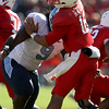 Nov 28, 2009; Raleigh, NC, USA; North Carolina State Wolfpack quarterback Russell Wilson (16) is hit by North Carolina Tar Heels defensive tackle Marvin Austin (9) during the first half at Carter-Finley Stadium.  The Wolfpack defeated the Tar Heels 28-27.  Mandatory Credit: Brian Utesch-US PRESSWIRE
