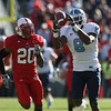 Nov 28, 2009; Raleigh, NC, USA; North Carolina Tar Heel wide receiver Greg Little (8) catches a pass against North Carolina State Wolfpack corner back C.J. Wilson (20) during the first half at Carter-Finley Stadium.  Mandatory Credit: Brian Utesch-US PRESSWIRE