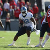 Nov 28, 2009; Raleigh, NC, USA; North Carolina Tar Heels tailback Ryan Houston (32) runs the ball against the North Carolina State Wolfpack during the first half at Carter-Finley Stadium.  The Wolfpack defeated the Tar Heels 28-27.  Mandatory Credit: Brian Utesch-US PRESSWIRE