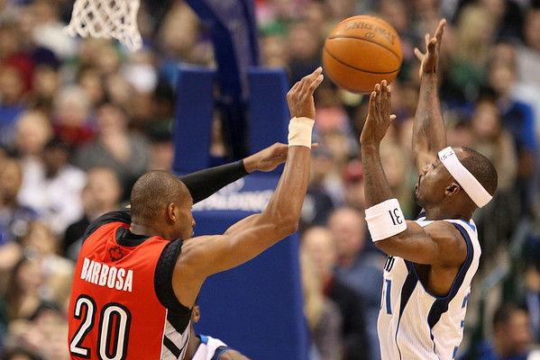 Dec 28, 2010; Dallas, TX, USA; Dallas Mavericks guard Jason Terry (right) defends a pass from Toronto Raptors guard Leandro Barbosa (20) during the first half at the American Airlines Center.  The Raptors defeated the Mavericks 84-76.  Mandatory Credit: Brian Utesch-US PRESSWIRE