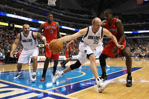 Dec 28, 2010; Dallas, TX, USA; Dallas Mavericks forward Brian Cardinal (35) grabs a rebound while defended by Toronto Raptors forward Ed Davis (32) during the second half at the American Airlines Center.  The Raptors defeated the Mavericks 84-76.  Mandatory Credit: Brian Utesch-US PRESSWIRE