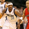 Dec 28, 2010; Dallas, TX, USA; Dallas Mavericks guard Jason Terry (31) carries the ball up the court while Toronto Raptors guard Jerryd Bayless (5) pursues during the first half at the American Airlines Center.  Mandatory Credit: Brian Utesch-US PRESSWIRE