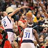 Dec 28, 2010; Dallas, TX, USA; Toronto Raptors forward Linas Kleiza (middle) drives to the basket while Dallas Mavericks guard Jason Kidd (2) and guard Jason Terry (31) and center Tyson Chandler (6) defend during the first half at the American Airlines Center.  The Raptors defeated the Mavericks 84-76.  Mandatory Credit: Brian Utesch-US PRESSWIRE