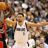 Dec 28, 2010; Dallas, TX, USA; Dallas Mavericks center Tyson Chandler (6) guards Toronto Raptors center Amir Johnson (15) during the first half at the American Airlines Center.  The Raptors defeated the Mavericks 84-76.  Mandatory Credit: Brian Utesch-US PRESSWIRE