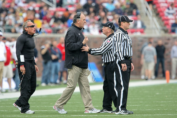 Dec 30, 2010; Dallas, TX, USA; SMU Mustangs head coach June Jones argues a call against the Amy Black Knights during the first half of the 2010 Armed Forces Bowl at Gerald J. Ford Stadium.  Mandatory Credit: Brian Utesch-US PRESSWIRE