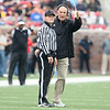 Dec 30, 2010; Dallas, TX, USA; SMU Mustangs head coach June Jones discusses a call with an official during the first half against the Army Black Knights in the 2010 Armed Forces Bowl at Gerald J. Ford Stadium.  The Black Knights defeated the Mustangs 16-14.  Mandatory Credit: Brian Utesch-US PRESSWIRE