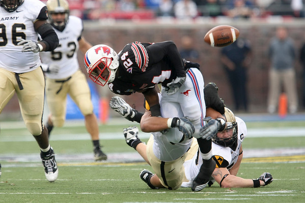 Dec 30, 2010; Dallas, TX, USA; SMU Mustangs wide receiver Aldrick Robinson (24) fumbles the ball against the Army Black Knights during the first half of the 2010 Armed Forces Bowl at Gerald J. Ford Stadium.  Mandatory Credit: Brian Utesch-US PRESSWIRE