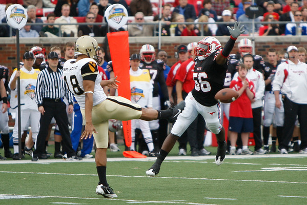 Dec 30, 2010; Dallas, TX, USA; SMU Mustangs linebacker Ja'Gared Davis (56) attempts to block the punt of Army Black Knights punter Jonathan Bulls (18) during the second half of the 2010 Armed Forces Bowl at Gerald J. Ford Stadium.  The Black Knights defeated the Mustangs 16-14.  Mandatory Credit: Brian Utesch-US PRESSWIRE