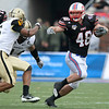 Dec 30, 2010; Dallas, TX, USA; SMU Mustangs running back Zach Line (48) runs the ball while Army Black Knights defensive back Donovan Travis (6) and defensive end Joshua McNary (44) pursue during the second half of the 2010 Armed Forces Bowl at Gerald J. Ford Stadium.  The Black Knights defeated the Mustangs 16-14.  Mandatory Credit: Brian Utesch-US PRESSWIRE