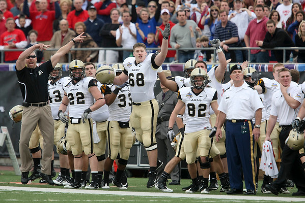 Dec 30, 2010; Dallas, TX, USA; Army Black Knights players and coaches celebrate a missed field goal by the SMU Mustangs during the second half of the 2010 Armed Forces Bowl at Gerald J. Ford Stadium.  The Black Knights defeated the Mustangs 16-14.  Mandatory Credit: Brian Utesch-US PRESSWIRE