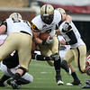Dec 30, 2010; Dallas, TX, USA; Army Black Knights fullback Jared Hassin (7) runs the ball against the SMU Mustangs during the first half of the 2010 Armed Forces Bowl at Gerald J. Ford Stadium.  The Black Knights defeated the Mustangs 16-14.  Mandatory Credit: Brian Utesch-US PRESSWIRE