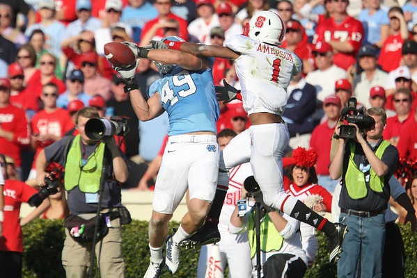 Nov 20, 2010; Chapel Hill, NC, USA; North Carolina Tar Heels tight end Ryan Taylor (49) catches a pass while defended by North Carolina State Wolfpack defensive back David Amerson (1) during the second half at Kenan Stadium.  The Wolfpack defeated the Tar Heels 29-25.  Mandatory Credit: Brian Utesch-US PRESSWIRE
