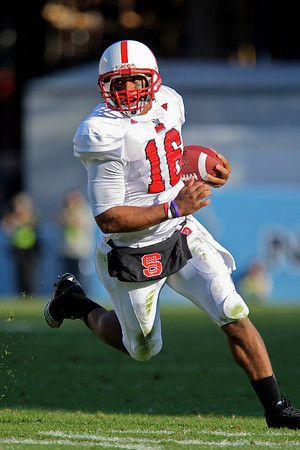 Nov 20, 2010; Chapel Hill, NC, USA; North Carolina State Wolfpack quarterback Russell Wilson (16) runs with the ball against the North Carolina Tar Heels during the second half at Kenan Stadium.  The Wolfpack defeated the Tar Heels 29-25.  Mandatory Credit: Brian Utesch-US PRESSWIRE