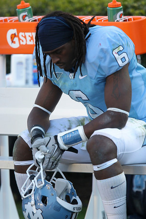Nov 20, 2010; Chapel Hill, NC, USA; North Carolina Tar Heels running back Anthony Elzy (6) on the bench at the end of the game against the North Carolina State Wolfpack at Kenan Stadium.  The Wolfpack defeated the Tar Heels 29-25.  Mandatory Credit: Brian Utesch-US PRESSWIRE