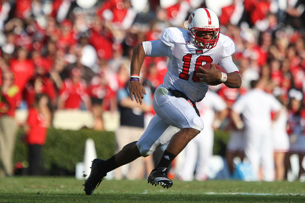Nov 20, 2010; Chapel Hill, NC, USA; North Carolina State Wolfpack quarterback Russell Wilson (16) runs with the ball during the second half against the North Carolina Tar Heels at Kenan Stadium.  The Wolfpack defeated the Tar Heels 29-25.  Mandatory Credit: Brian Utesch-US PRESSWIRE