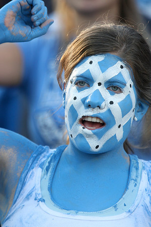 Nov 20, 2010; Chapel Hill, NC, USA; A North Carolina Tar Heels fan cheers during the second half against the North Carolina State Wolfpack at Kenan Stadium.  The Wolfpack defeated the Tar Heels 29-25.  Mandatory Credit: Brian Utesch-US PRESSWIRE