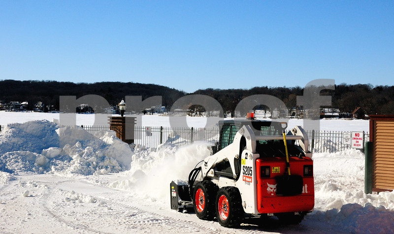 MOVING MORE SNOW TO FINISH BUILDING THE SNOW BLOCKS AROUND TOWN