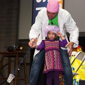 Ana Ines (age 3) from  Potomac Maryland demonstrates centrifugal force with Dr. Molecule.