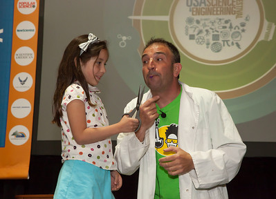 Christina (age 7) of Reston VA is on stage with Dr. Molecule.