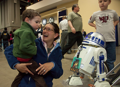 Daniele Schiffman and Justin (age 2) have fun with robots