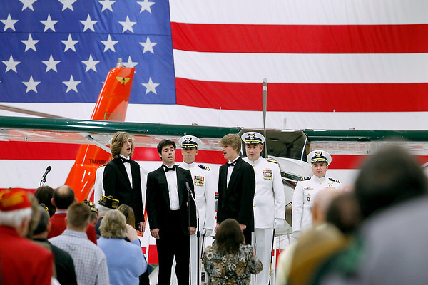 "Record-Eagle/Jan-Michael Stump<br /> The Traverse City Central High School Boys Quintet sings ""Semper Paratus,"" the U.S. Coast Guard's service song, during Friday's Change of Command Ceremony at Air Station Traverse City. Cmdr Joseph Buzzella, Jr. relieves Cmdr Jonathan Spaner as head of the station."