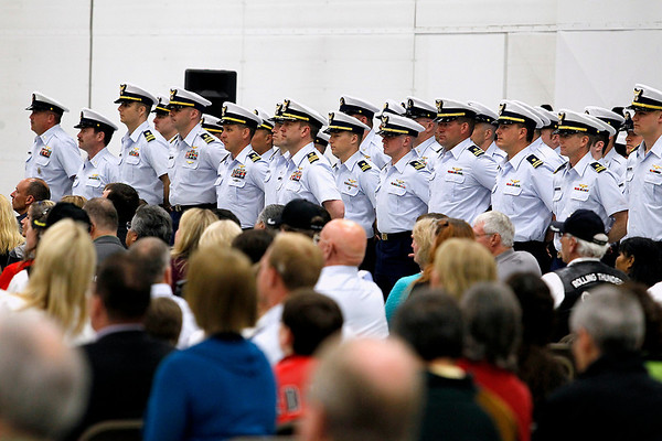 Record-Eagle/Jan-Michael Stump<br /> U.S. Coast Guard Air Station Traverse City crew members stand the hangar for the start of Friday's Change of Command Ceremony, as Cmdr Joseph Buzzella, Jr. relieves Cmdr Jonathan Spaner as head of the station.